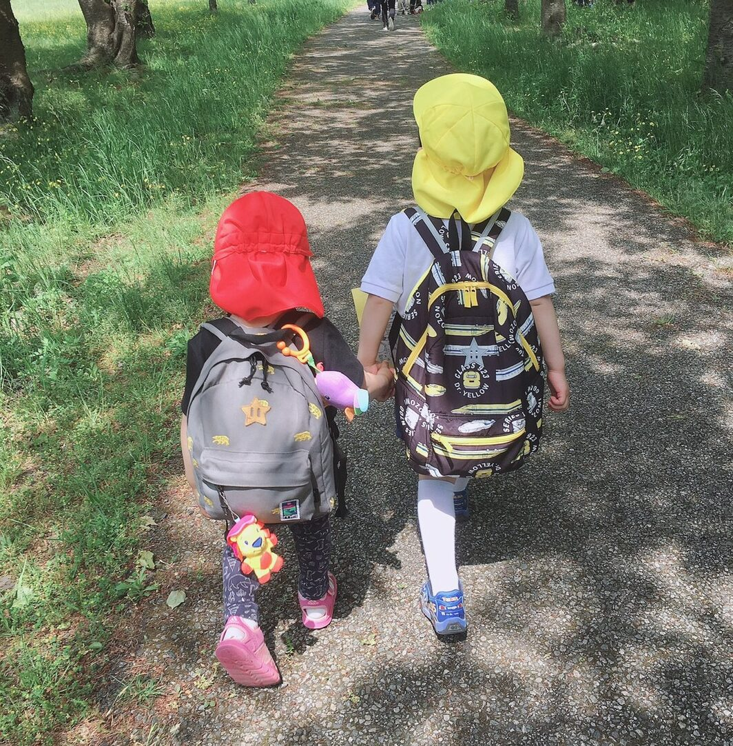 backpacks holding hands